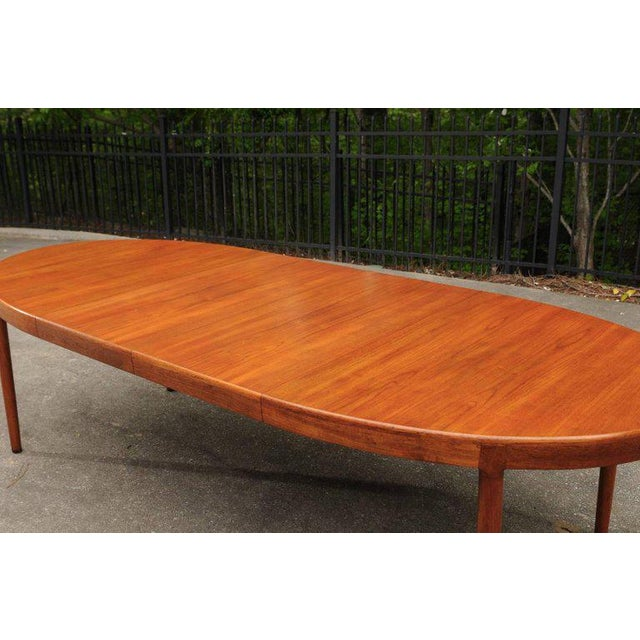 A stunning extension dining table by Harry Ostergaard for Randers Mobelfabrik, circa 1963. Clean and elegant design...