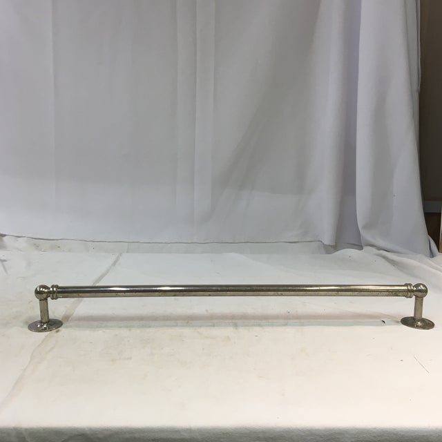 This antique towel bar from the 1910s is a beautiful piece. The entire bar is made out of nickel-plated brass.. Amazing...