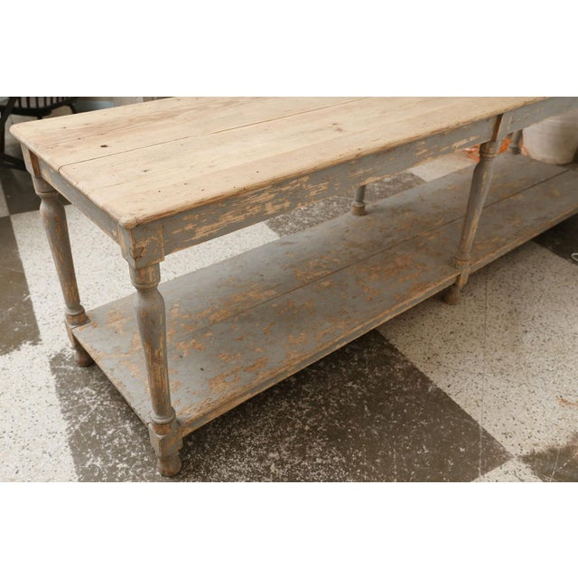 Massive French drapers table: Nice, thick two plank pine scrubbed top raised upon six turned legs. Top's edges are...