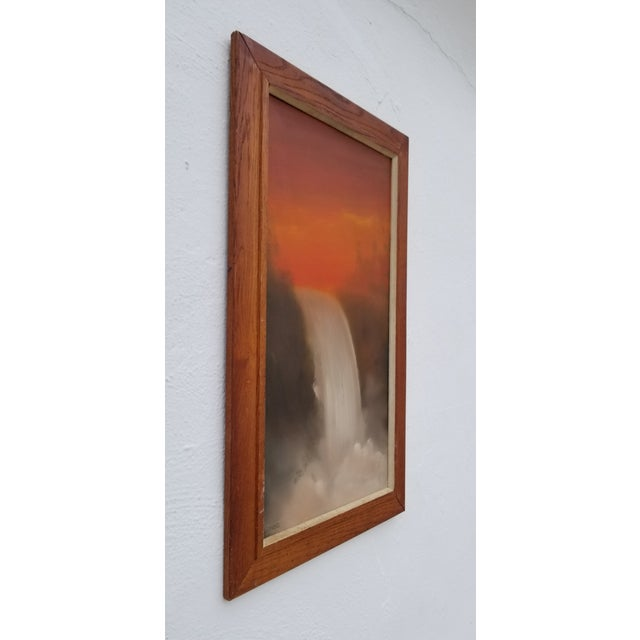 Presented for sale is a stunning Mid-century waterfall landscape painting, signed on the bottom left by listed artist...