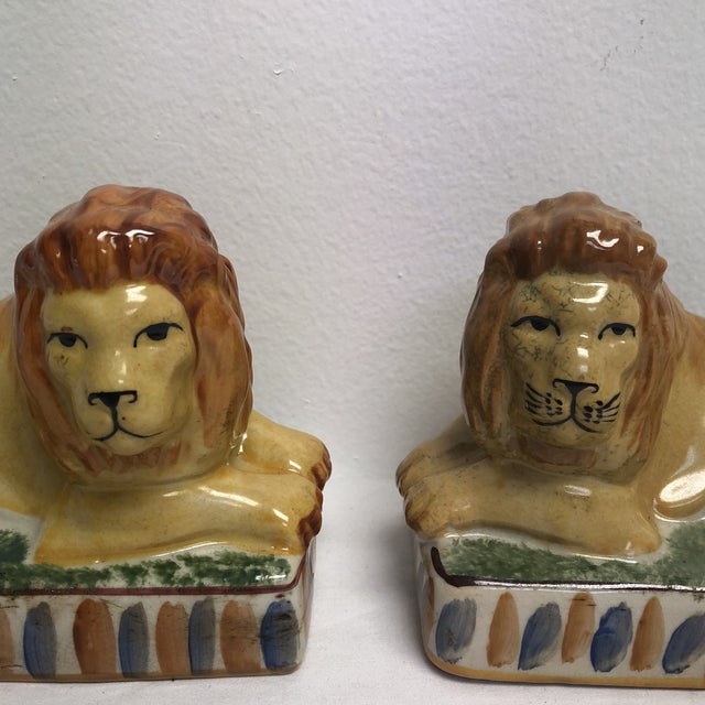 Pair of Staffordshire style lions laying down.