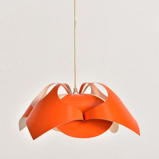 Here is your finishing piece that will tie in your space age look or your midcentury style.