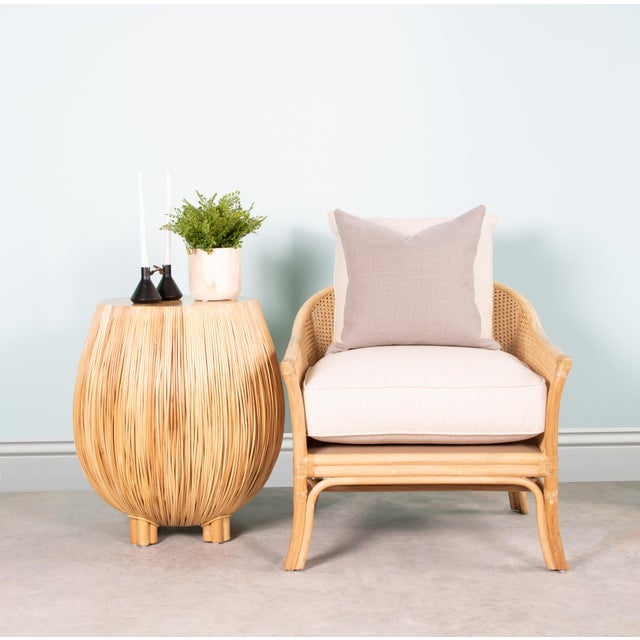 This David Francis rattan and cane lounge chair features a rattan frame with rawhide bindings and an upholstered webbed...