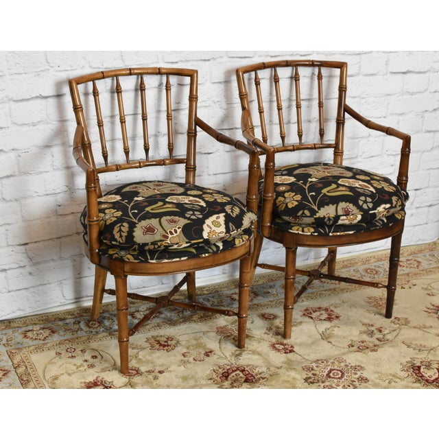 Beautiful pair of Drexel Heritage Faux Bamboo Arm Chairs in their original natural finish upholstered in a modern stylish...