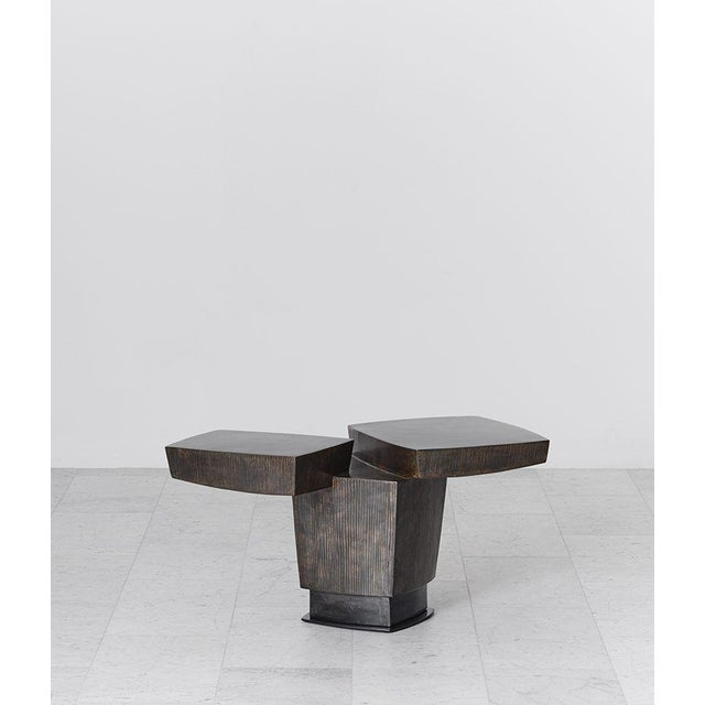 Gary Magakis' handmade Ledges 2 Side Table reflects the sculptor's distinct approach to creating bold and dense geometric...