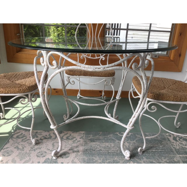 Stunning vintage patio/porch dining set. Made of real wrought iron, this set is painted white and distressed. The four...