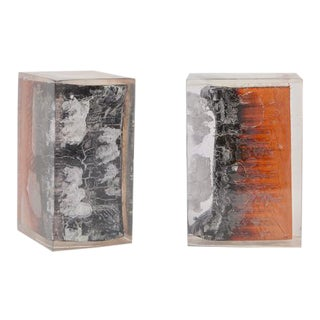 A Pair of Burnt Wood and Resin Block Bookends For Sale