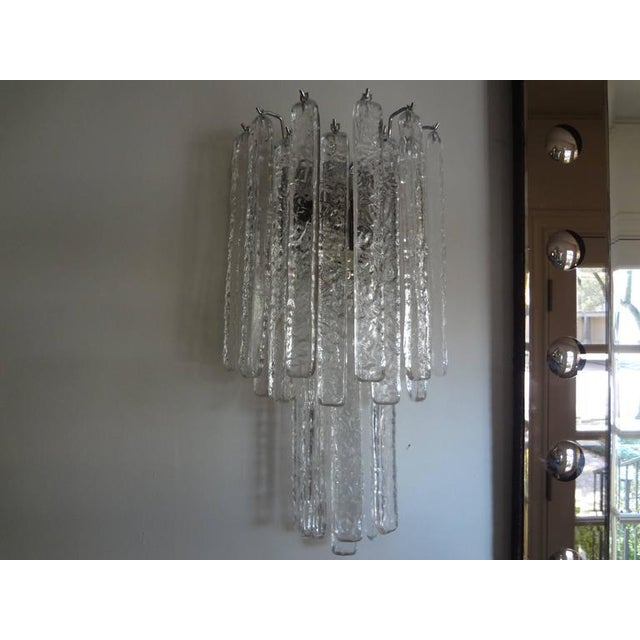 Gorgeous pair of Venini style Italian Murano glass sconces on chrome structures. These beautiful Murano glass icicle...