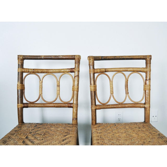 Pair of Antique 1920's Bamboo + Rattan Chairs This is a lovely pair of antique bamboo + rattan side chairs! They are...