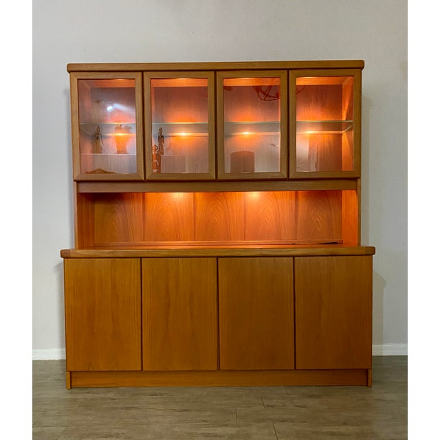 A stunning Danish buffet and hutch by Christian Linneberg. This piece is made of teak wood and is in exceptional condition...