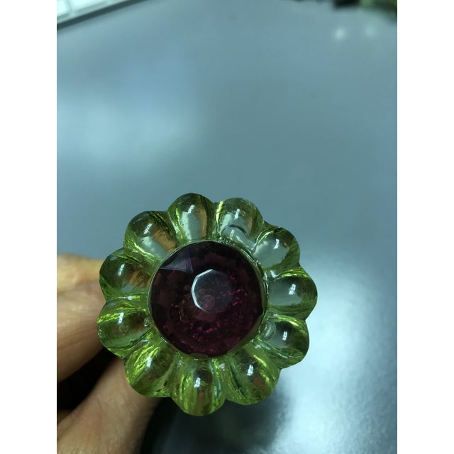 Green and purple Electra flower glass knobs from Anthropologie. Use them to transform dressers or cabinets.