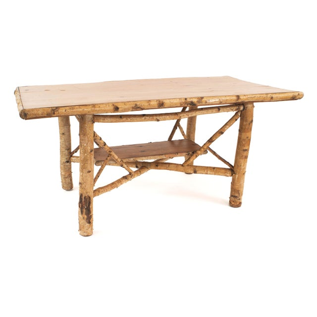 Rustic Adirondack (First half of the 20th century) rectangular birchwood dining table with stretcher base and blond wood...