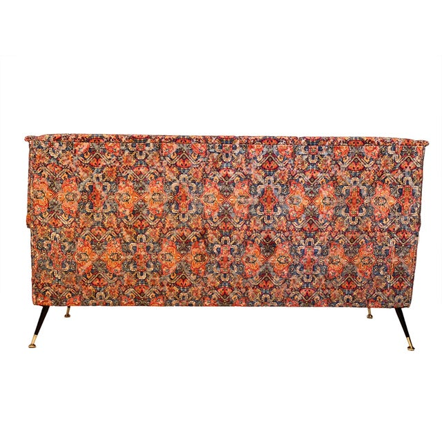 Vintage Italian sofa from Milan featuring unique Rubelli fabric mimicking an antique worn Persian rug. Steel and brass...