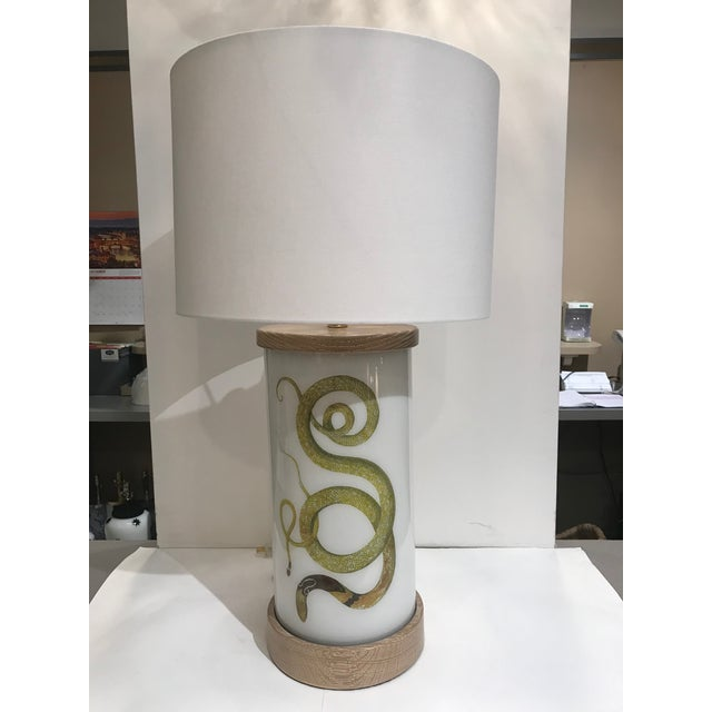 This unique handmade decoupage lamp starts out as a blown glass cylinder. After the image is decoupaged, numerous coats of...