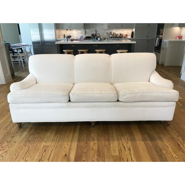 Immaculate white English-rolled arm sofa with Ralph Lauren fabric. Brass castors on legs. Excellent condition and fabric...