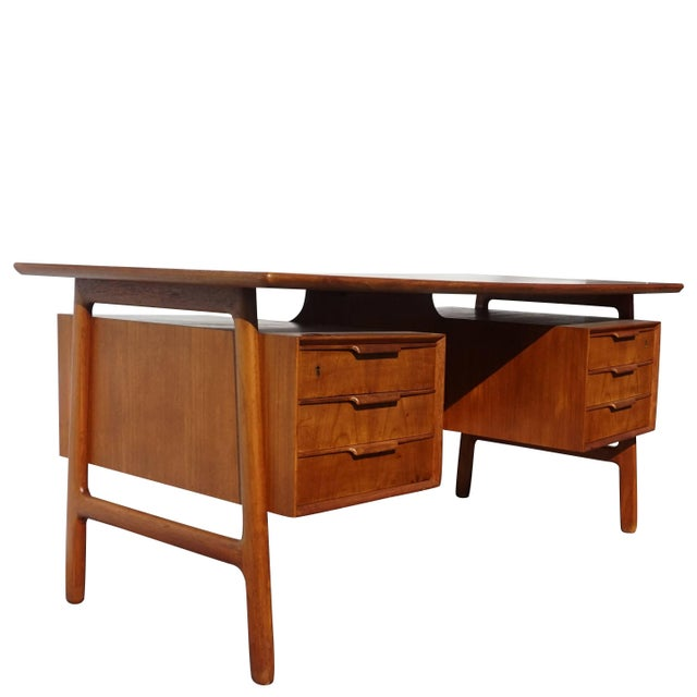 20th century Danish writing desk made of cherry and beechwood with three drawers on each side, circa 1960, Denmark...