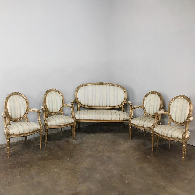 19th Century French Louis XVI Giltwood Sofa represents the epitome of the craftsmanship from the Belle Epoque period in...