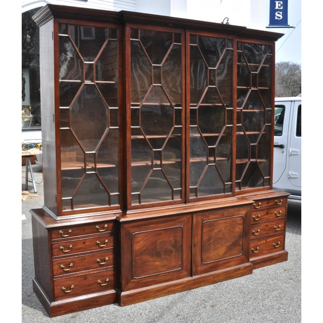 Period 18th century Georgian step front breakfront bookcase cabinet --Beautifully figured mahogany bookmatched throughout....