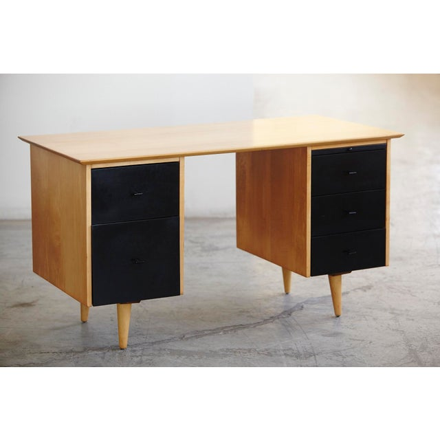 Very stylish desk with double sided pedestals with 5 satin black painted solid birch drawers (2 + 3 + 1 tray). The back,...