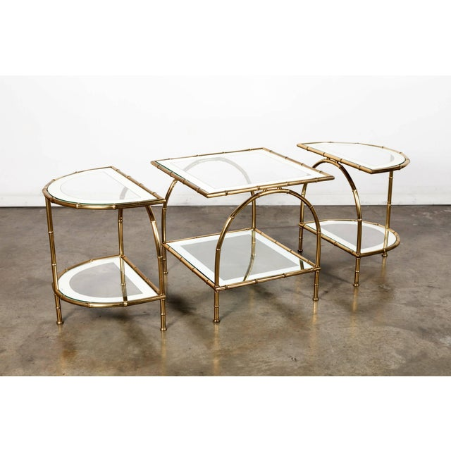 Stunning midcentury faux bamboo brass cocktail or coffee table by renowned French design house Maison Baguès composed of a...