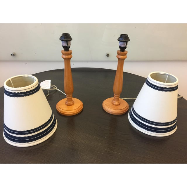 Two wooden table lamps with vintage lamp shades.