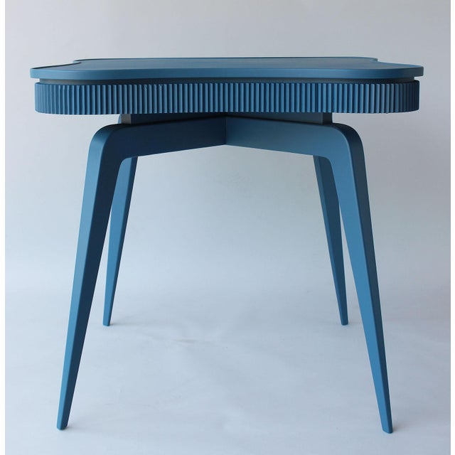A fabulous mid-century Italian dining or game table in teal blue, with four pocket drawers, attributed to Paolo Buffa. Set...