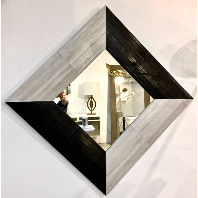 An Italian modern black and ivory gray / white square mirror, Minimalist fine design, entirely handcrafted. The slightly...