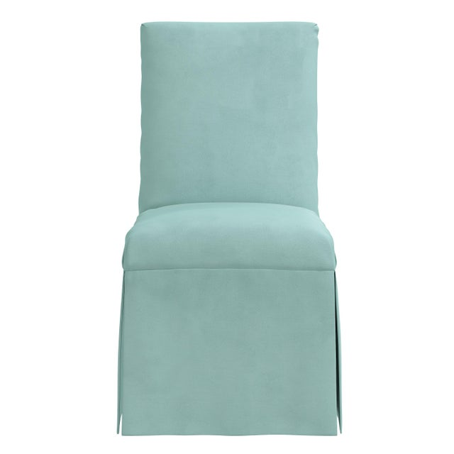 Finish your dining room with a touch of elegance with this Slipcover Dining Chair. This pretty dining chair features a...