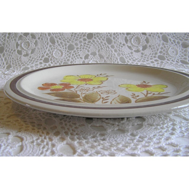 This vintage floral stoneware platter was made in Japan in the 1970s. It would make a lovely addition to any country,...