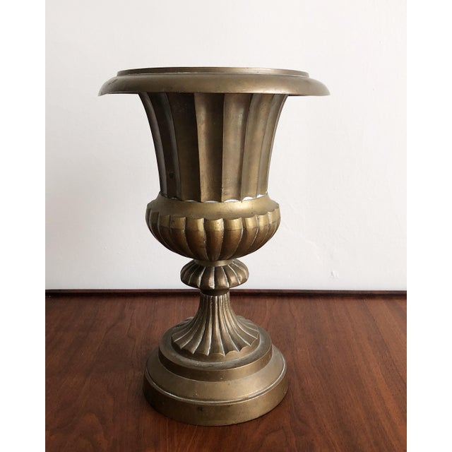 Large elegant solid brass planter or urn vase in a Neoclassical Hollywood Regency style. Slight bend to the edge is not so...