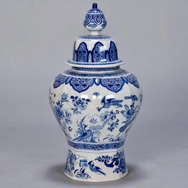 Large early 20th century ginger jar in classic blue and white glaze depicts peacocks, flowers, butterflies and decorative...