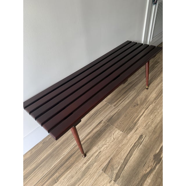 Newly refinished vintage mid century slat bench. Circa 1960's, this wood bench has plenty of cool mid century appeal, with...