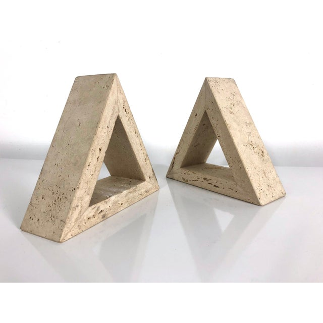 Pair of travertine triangle form bookends Made in Italy by Fratelli Mannelli for Raymor, circa 1960's. Geometric and...