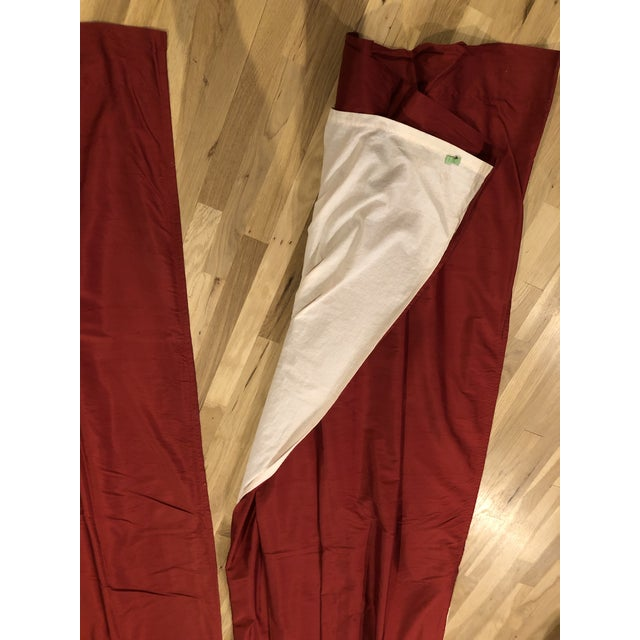 "These draperies are in a beautiful, deep red silk and are fully lined. Each panel ( there are 2 ) measures 98"" long and..."