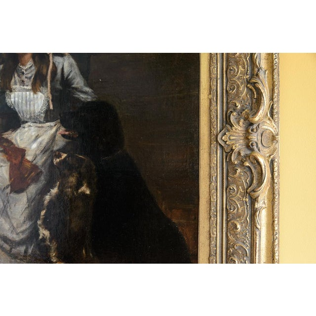 19th Century oil painting of lady with dogs and cat.