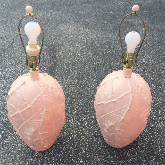 """A pair of vintage banana leaf frond ceramic blush pink table lamps. 16"""" to base of harp 26.75"""" to top of finial 10"""" wide"""