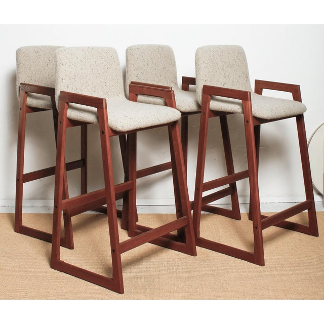 Set of four 1960s Danish teak bar stools, professionally re-finished and upholstered in a heavy brushed linen tweed with...