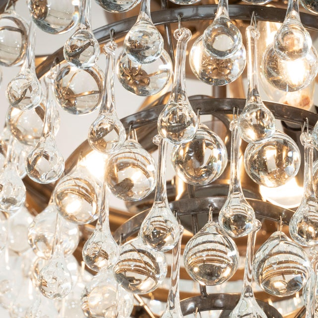 This stunning five-tier modernist chandelier was realized in the United States. The fixture offers an abundance of hand-...