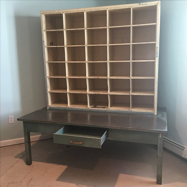 "Circa 1960 US postal sorting desk with attached mail compartments. There are 30 mail cubbies that each measure 7 1/4"" H X..."