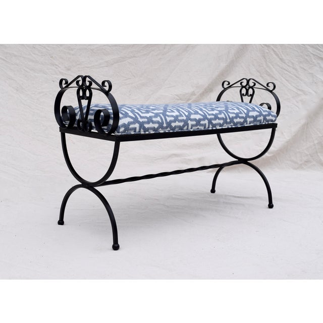 A wrought Iron Curule base bench with scroll design elements to the arms, turned stretcher & new trellis pattern...