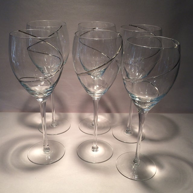 These are 6 stunning silver swirl crystal wine glasses. The glass is hand blown and the silver is laid on the glass. Very...