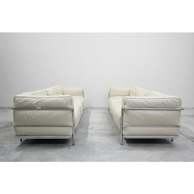 A RARE pair of LC3 Grand Modele Sofas designed by Le Corbusier, Pierre Jeanneret and Charlotte Perriand, produced by...