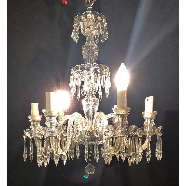 A Venetian Six Light Cut Crystal Chandelier circa 1920. The center column having six cut arms flowing with crystal drops....