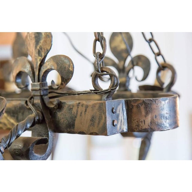 French Country Four Light Hand-Forged Iron Fleur De Lis Chandelier For Sale - Image 10 of 10