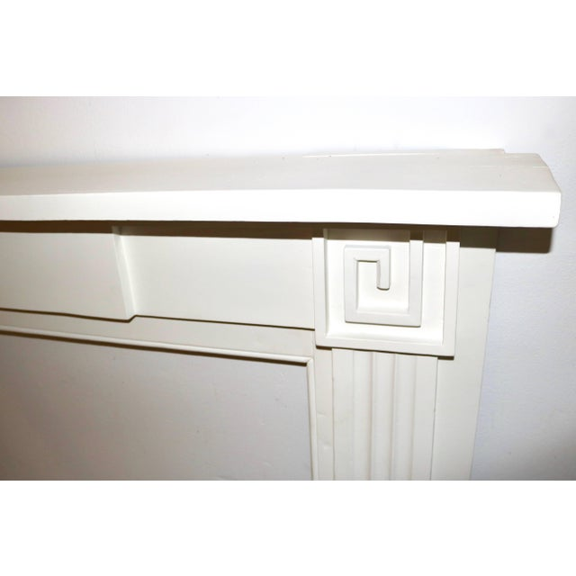 This 19th century American Greek Revival mantle has been professionally restored and is now painted in a white primer....