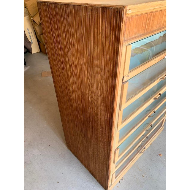 Vintage industrial storage cabinet that would be great for an expert crafter or in a wood shop. Lots and lots of storage.