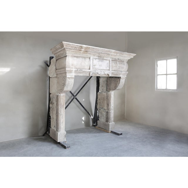 A stately antique castle fireplace with lots of allure, decorated with ornaments and with beautiful lines. There is a...