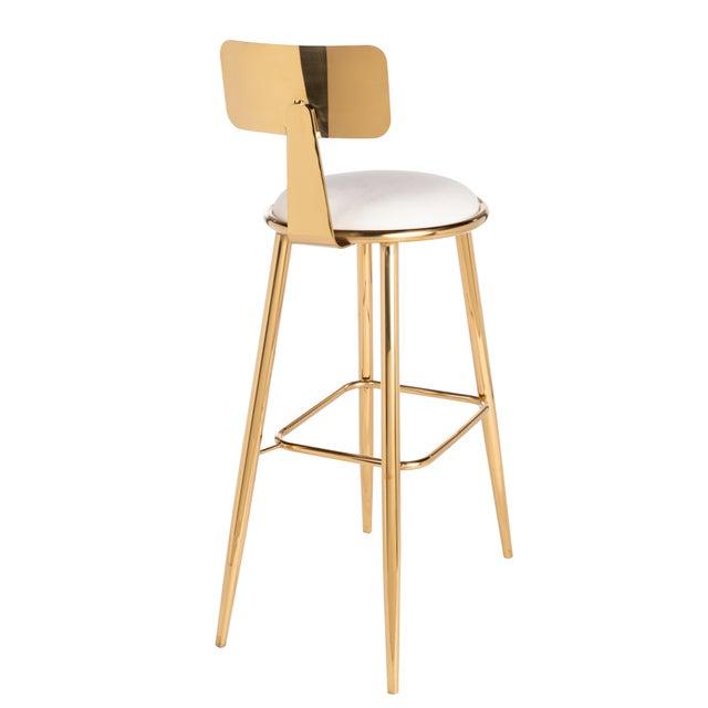 Modern bar stool upholstered in white velvet set.Materials: Stainless steel, velvet.Color: Gold, white.Seat measurements:...
