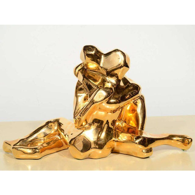 This dynamic and graphic 24-karatt gold plated ceramic sculpture was realized by Jaru of California, circa 1970. Entitled...