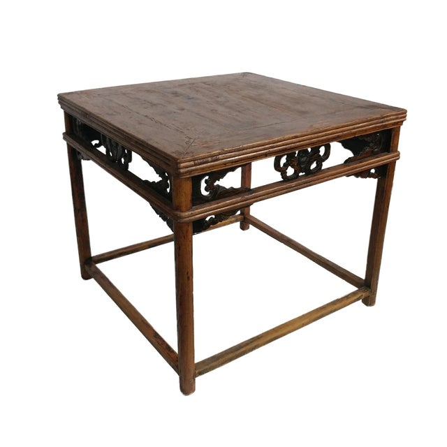 With detailed engravings, and a warm finish, this antique dining table circa 1890 from the Ningbo Province, offers an...